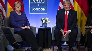 President Donald Trump meets with German Chancellor Angela Merkel during the NATO summit at The Grove, UK