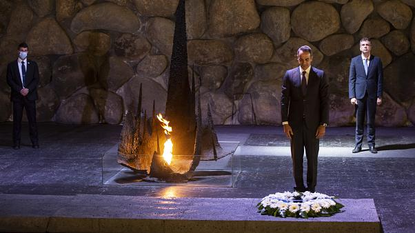 Greek Prime Minister Kyriakos Mitsotakis stands during a ceremony in the Hall of Remembrance at the Yad Vashem Holocaust Museum in Jerusalem