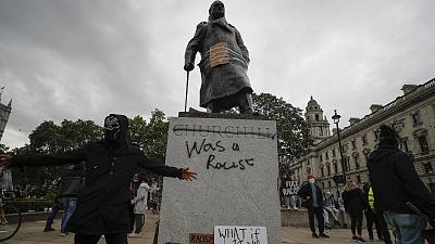 Protesters gather around Winston Churchill statue in Parliament Square during the Black Lives Matter protest rally in London.