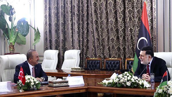 Turkey's Foreign Minister Mevlut Cavusoglu, right, and Fayez Sarraj