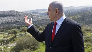 In this Feb. 20, 2020 photo, Israeli Prime Minister Benjamin Netanyahu visits the area where a new neighborhood is to be built in the East Jerusalem settlement of Har Homa.