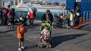 Refugees and migrants wearing masks arrive at the port of Piraeus, near Athens. 11 June 2020.