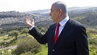 In this Feb. 20, 2020 file photo, Israeli Prime Minister Benjamin Netanyahu visits the area where a new neighborhood is to be built in the East Jerusalem settlement of Har Hom