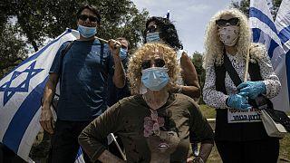 Supporters of Prime Minister Benjamin Netanyahu wear a masks, Israel