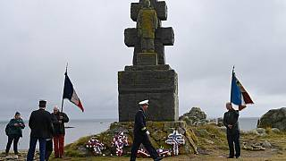 "People take part in a ceremony to commemorate General de Gaulle's ""Appeal of June 18th"" during World War II, in the island of Ile-de-Sein, on June 18, 2020."
