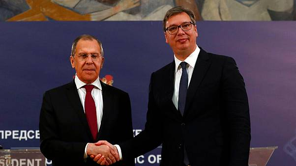 Russian Foreign Minister Sergey Lavrov, left, shakes hands with Serbia's President Aleksandar Vucic after a joint press conference in Belgrade, Serbia, Thursday, June 18, 2020