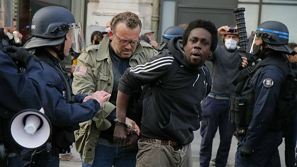 A protester is detained during an anti-racism demonstration, Thursday, June 4, 2020 in Lille, northern France