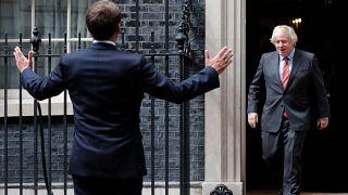 Boris Johnson greets Emmanuel Macron