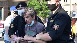 Belarus' riot police detain a protester in Minsk on June 19, 2020