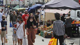 Customers walk along Portobello Road Market in London, Wednesday, May 27, 2020.
