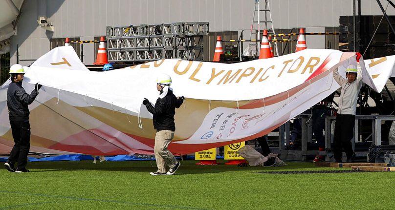 Kyodo News/AP
