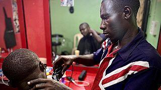 جايمس عاد إلى نيجيريا قادما من ليبيا بعد أن ساعدته المنظمة الدولية للهجرة على فتح محل حلاقة