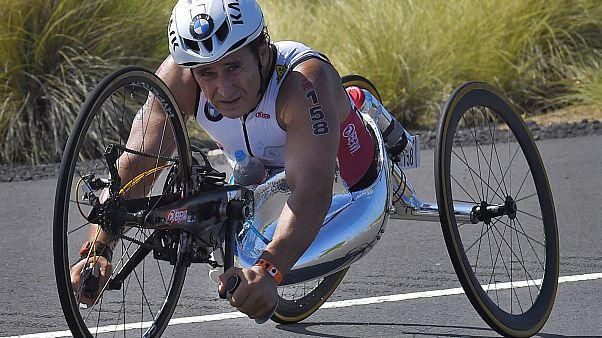 Alex Zanardi rides during the cycling portion of the Ironman World Championship Triathlon, in Kailua-Kona, Hawaii, October 10, 2015