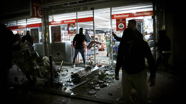 Goods lie on the floor after people broke into a shop on Marienstrasse in Stuttgart, Germany, Sunday, June 21, 2020.