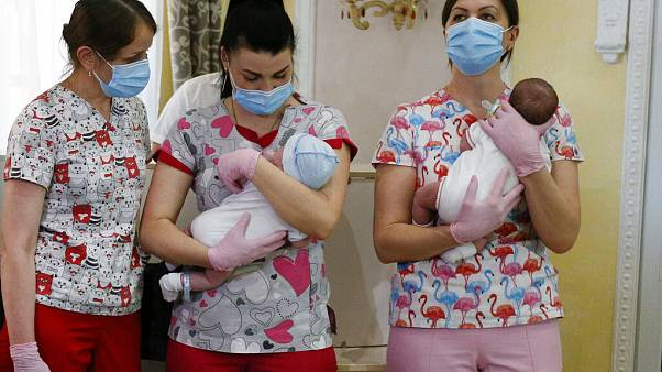 Nurses hold babies