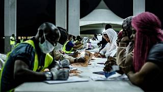 Nigerian migrants are registered after returning to Lagos from Libya in February 2020