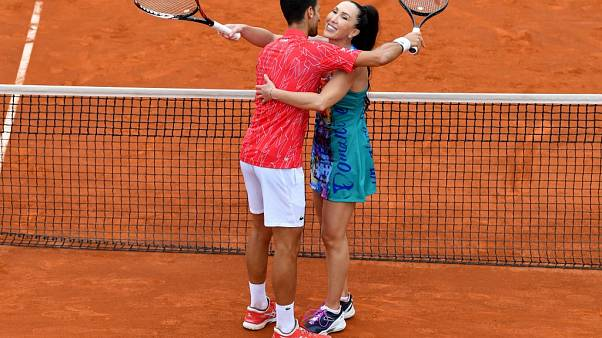 On June 12, 2020 Serbia's Novak Djokovic hugs Jelena Jankovic during a charity exhibition in Belgrade