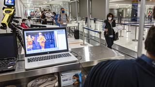A laptop screen from an infrared camera monitoring the ambient body temperatures of incoming travellers arriving at Cyprus' Larnaca International Airport, June 9, 2020.