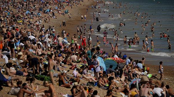On Britain's hottest day of the year so far with temperatures reaching 32.6 degrees at Heathrow, people relax on Brighton Beach in Brighton, England, Wednesday