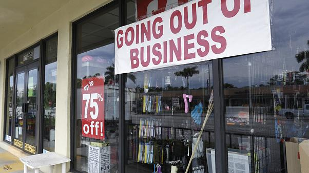 "a store with a ""Going out of Business,"" sign is shown in North Miami Beach."