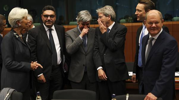ECB President Christine Lagarde (L) with euro zone finance ministers during a January 2020 Eurogroup meeting.
