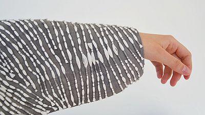 Designer makes eco-friendly burial clothes.