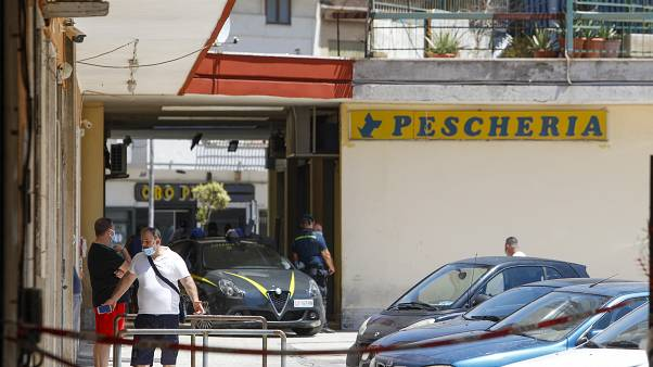 Police officers patrol an apartment complex area, Mondragone, Campania, Friday, June 26, 2020.