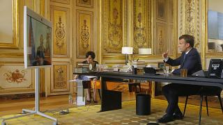 French President Emmanuel Macron talks to Russian President Vladimir Putin during a video conference Friday, June 26, 2020