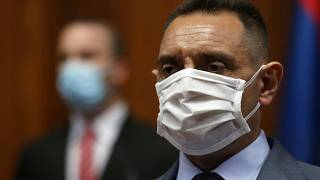 In this Tuesday, April 28, 2020. file photo, Serbia Defense Minister Aleksandar Vulin wearing a mask to protect against coronavirus attends the session in Belgrade, Serbia.