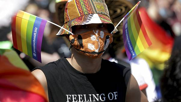 A protester takes part in an LGBTQ+ rally in Berlin, Germany, Saturday, June 27, 2020.