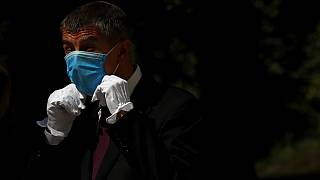 Czech Republic's Prime Minister Andrej Babis adjusts his face mask as he waits for the arrival of his Slovak counterpart Igor Matovic in Prague, Czech Republic, June 3, 2020