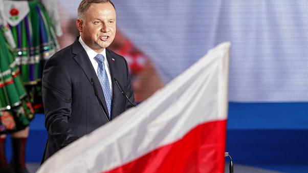 President Andrzej Duda addressees supporters shortly after voting ended in the presidential election in Lowicz, Poland, Sunday, June 28, 2020