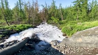 According to Novaya Gazeta, this 28 June 2020 picture shows water from a Nornickel enrichment plant gushing out of a pipe and into a river running into a nearby lake
