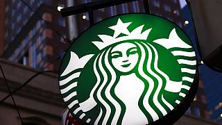 This June 26, 2019, file photo shows a Starbucks sign outside a Starbucks coffee shop in downtown Pittsburgh, US