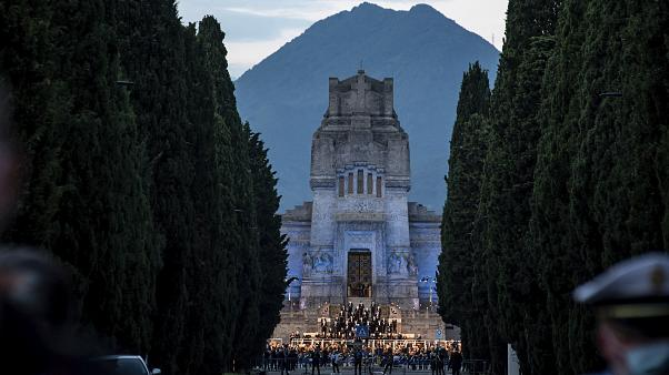 Musicians perform in front of the Bergamo cemetery, Italy, Sunday, June 28, 2020.