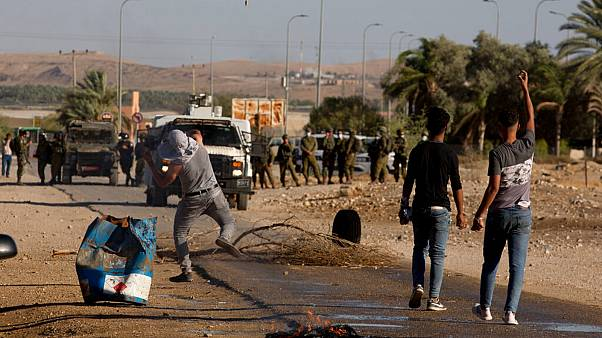 Palestinian demonstrators clash with the Israeli troops during a protest against Israel's plan to annex parts of the West Bank in Fasayil, in the Jordan Valley, Jun. 24, 2020.