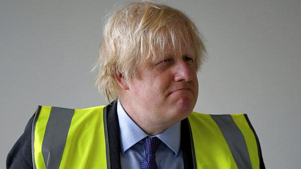 Britain's Prime Minister Boris Johnson visits the construction site of Ealing Fields High School in west London, Monday June 29, 2020