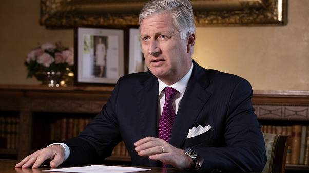 Belgium's King Philippe addresses the nation regarding the coronavirus in a televised broadcast at the Royal Palace in Brussels, Monday, March 16, 2020.