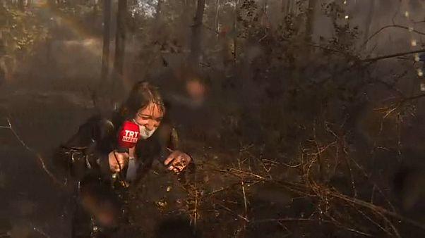 Mitten im Live: 1.000 Liter Wasser aus dem Heli auf die Journalistin