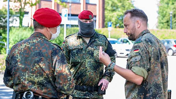 Soldiers of the German forces stay in front of the district hall, headquarters of the task force coordinating coronavirus test stations, in Warendorf, Germany, June 24, 2020.