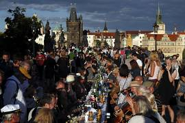 Residents sit to dine on a 500 metre long table set on the medieval Charles Bridge, after restrictions were eased following the coronavirus pandemic in Prague, Czech Republic