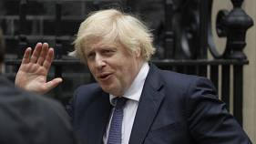 British Prime Minister Boris Johnson waves at the media as he leaves 10 Downing Street in London, to attend the weekly Prime Minister's Questions in Parliament, July 1, 2020,