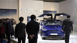 People view the new Tesla Model X during the Brussels Auto Show at the Expo in Brussels, Thursday, Jan. 9, 2020.