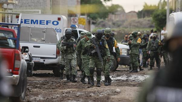 Members of the national guard walk near an unregistered drug rehabilitation center in Irapuato, Mexico, Wednesday, July 1, 2020.