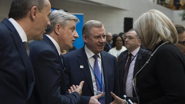 Yakiv Smolii, governor of Ukraine's central bank (C), greets attendees during the IMF/World Bank spring meeting in Washington, DC on April 21, 2018.