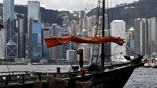 A sailor wearing a face mask to prevent the spread of the new coronavirus, works on a Chinese junk at the Victoria Harbour of Hong Kong, June 27, 2020.
