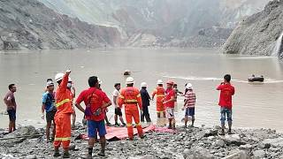 Myanmar Fire Services Department rescuers attempting to locate survivors after a landslide at a jade mine on July 2, 2020.