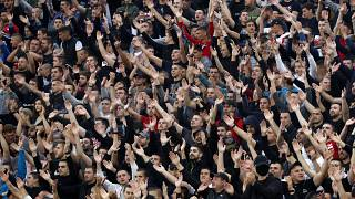 In this Wednesday, June 10, 2020. photo, Red Star fans support their team during a Serbian National Cup semi final soccer match between Partizan and Red Star in Belgrade.