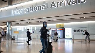 Passengers arrive at Heathrow airport