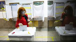 A voter wearing a face mask casts her ballot in Moscow, Russia. Russians vote on a constitutional reform that would allow President Vladimir Putin to stay in power until 2036